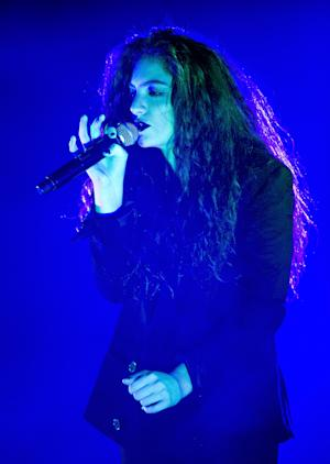 """FILE - This March 10, 2014 file photo shows New Zealand singer-songwriter Lorde performing in concert at Roseland in New York. Newcomers Lorde and Imagine Dragons are the top contenders at next month's Billboard Music Awards. The breakthrough acts are finalists in 12 categories, thanks to Lorde's Grammy-winning multiplatinum hit """"Royals"""" and Imagine Dragons' """"Radioactive,"""" also a multiplatinum Grammy winner. (Photo by Evan Agostini/Invision/AP, File)"""