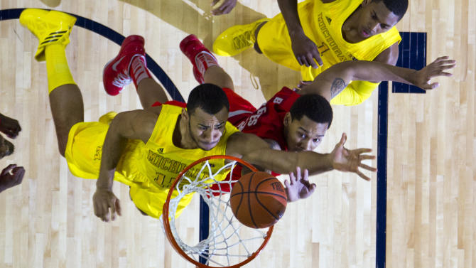 Michigan forward Jon Horford, left, tries to make a basket, defended by Ohio State center Amir Williams, in the first half of an NCAA college basketball game, Tuesday, Feb. 5, 2013, at Crisler Center in Ann Arbor, Mich. (AP Photo/Tony Ding)