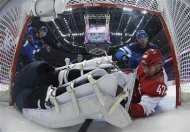 Russia's Alexander Radulov (47) falls into the Finland goal during the third period of their men's quarter-finals ice hockey game at the Sochi 2014 Winter Olympic Games February 19, 2014. REUTERS/Julio Cortez/Pool