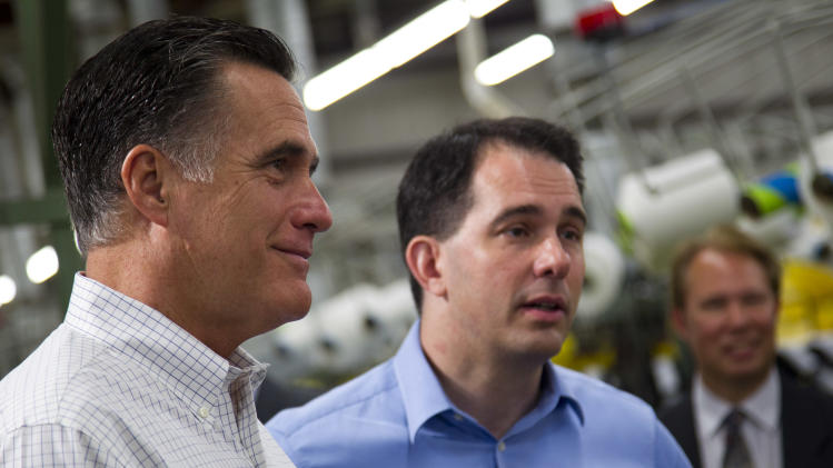 Republican presidential candidate, former Massachusetts Gov. Mitt Romney, left, stands with Gov. Scott Walker, R-Wis., during a campaign stop at Monterey Mills on Monday, June 18, 2012 in Janesville, Wis.  (AP Photo/Evan Vucci)
