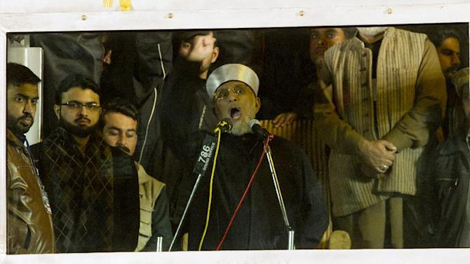 Pakistani Sunni Muslim cleric Tahir-ul-Qadri, addresses his supporters behind a bullet-proof glass, at a rally in Islamabad, Pakistan Tuesday, Jan. 15, 2013. Qadri said that the current government had lost their mandate and therefore he gave them a deadline till morning to resign from their assemblies on their own. (AP Photo/B.K. Bangash)