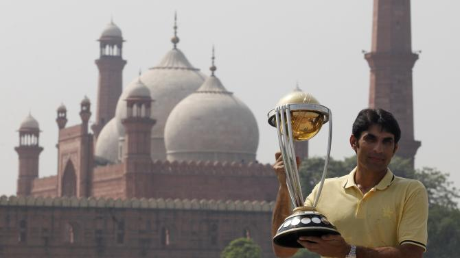 Misbah-ul-Haq, the captain of Pakistani Cricket Team holds the world cup trophy during the International Cricket Council Cricket World Cup 2015 trophy tour in Lahore