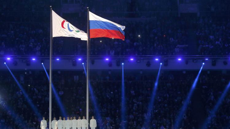 The Paralympic flag is seen besides the Russian national flag during the opening ceremony of the 2014 Paralympic Winter Games in Sochi