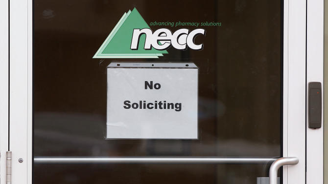 """FILE-In this Thursday, Oct. 4, 2012, file photo, a sign requesting """"No Soliciting"""" hangs on the door of the New England Compounding Center, the pharmacy that distributed a steroid linked to an outbreak of fungal meningitis, in Framingham, Mass. The New England Compounding Center announced Saturday, Oct. 6, 2012, in a news release a voluntary recall of all of its products. The company said in a news release that the move was taken out of an abundance of caution because of the risk of contamination. It says there is no indication that any other products have been contaminated. (AP Photo/Stephan Savoia, File)"""