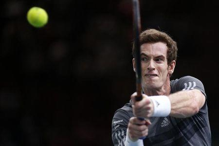 Murray of Britain returns a shot during his men's singles tennis match against Dimitrov of Bulgaria in the third round of the Paris Masters tennis tournament at the Bercy sports hall in Paris