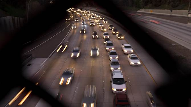 FILE - In this Tuesday, Nov. 22, 2011, file photo, cars fill the highway two days before Thanksgiving, in San Diego. The number of Americans hitting the road for Thanksgiving in 2012, is expected to increase slightly from a year ago, according to AAA's annual Thanksgiving travel forecast released Tuesday, Nov. 13, 2012. But they'll take shorter trips to save on gas and other costs as household budgets remain tight. (AP Photo/Gregory Bull, File)