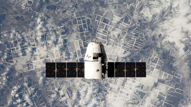 This image released by NASA shows the SpaceX Dragon capsule in orbit around Earth. The unmanned capsule splashed down in the Pacific on Tuesday, March 26, 2013 after a supply run to the International Space Station. (AP Photo/NASA)