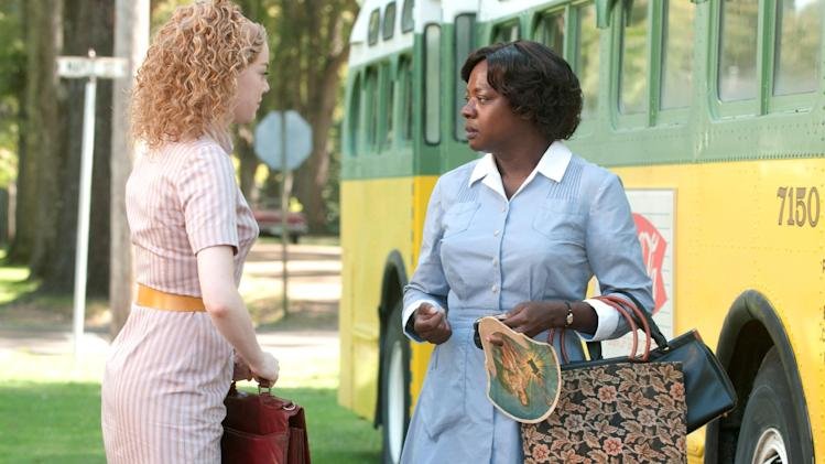 "In this film publicity image released by Disney, from left, Emma Stone and Viola Davis are shown in a scene from ""The Help.""  The declining DVD business has forced Hollywood to rethink what it's willing to pay to make a blockbuster.  While Hollywood's newfound cost-consciousness doesn't herald the coming of sock-puppet cinema, belt-tightening could favor more character-driven productions such as ""The Help,"" which struck box office gold with sales of $97 million so far, despite a cost of just $25 million to make. (AP Photo/Disney, Dale Robinette)"