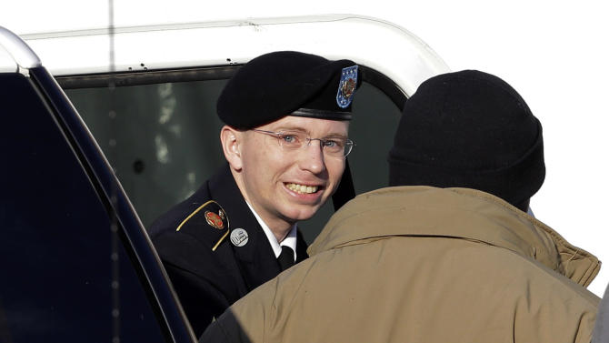 FILE - In this Nov. 28, 2012 file photo, Army Pfc. Bradley Manning, center, steps out of a security vehicle as he is escorted into a courthouse in Fort Meade, Md., for a pretrial hearing.  A military judge hears closing arguments on Tuesday, Dec. 12, 2012, on whether a private charged with sending classified material to WikiLeaks suffered illegal pretrial punishment during nine months in a Marine Corps brig. Army Pfc. Bradley Manning's lawyers claim his treatment was so egregious that all charges should be dismissed. (AP Photo/Patrick Semansky, HO)