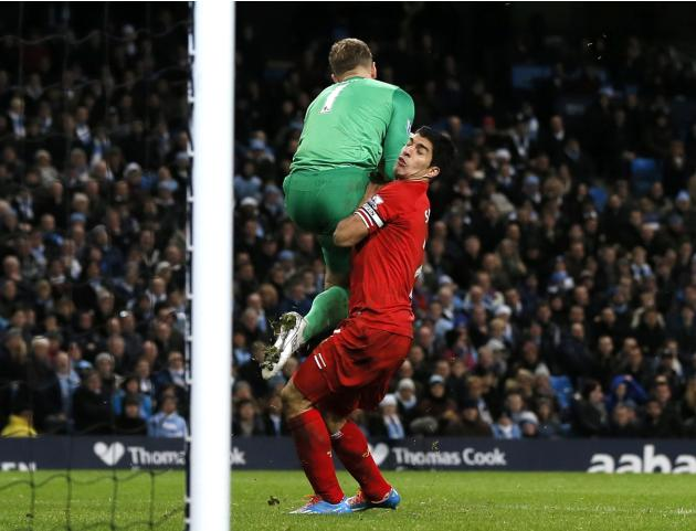 Liverpool's Suarez collides with Manchester City's Hart during their English Premier League soccer match in Manchester