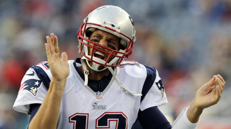 New England Patriots quarterback Tom Brady runs onto the field before an NFL preseason football game against the Carolina Panthers, Friday, Aug. 22, 2014, in Foxborough, Mass. (AP Photo/Charles Krupa)