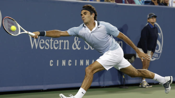 Roger Federer, from Switzerland, reaches for a forehand to Rafael Nadal, from Spain, during a quarterfinal at the Western & Southern Open tennis tournament, Friday, Aug. 16, 2013, in Mason, Ohio. (AP Photo/Al Behrman)