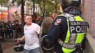 Dustin Anderson confronted a policeman during the Vancouver riot.
