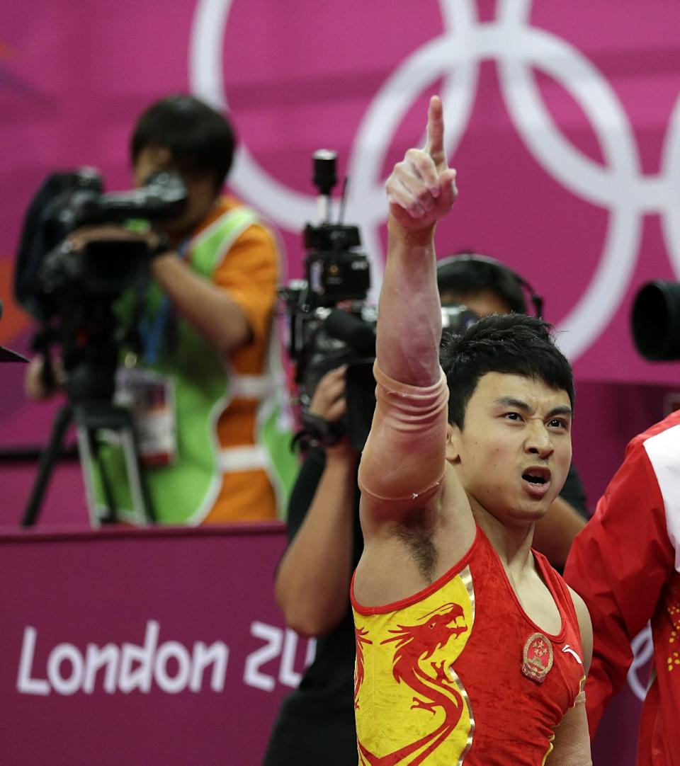 Chinese gymnast Feng Zhe celebrates after his performance on the parallel bars during the artistic gymnastics men's apparatus finals at the 2012 Summer Olympics, Tuesday, Aug. 7, 2012, in London. (AP Photo/Gregory Bull)