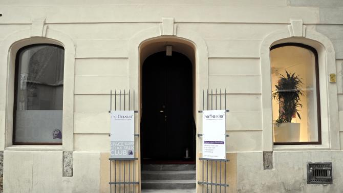 This picture taken Tuesday, Feb. 5, 2013, shows the entrance to the Reflexia Studio  in Vienna, Austria. One sleepy little side street in Vienna just got sleepier. Tucked away behind a Gothic church and surrounded by Renaissance-era houses, the new studio is offering deal-makers, movers and shakers and foot-sore tourists respite at a price — a half-hour power nap for 11 euros (US dollar 15). (AP Photo/Hans Punz)
