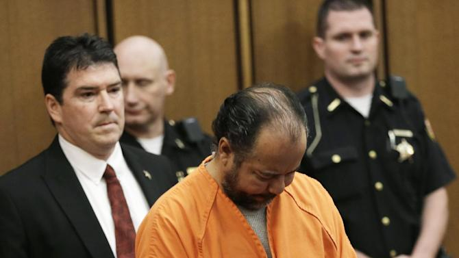 Ariel Castro walks into the courtroom during his arraignment Wednesday, June 12, 2013, in Cleveland. Castro, 52, is accused of holding three women captive in his Cleveland home for about a decade pleaded not guilty to hundreds of charges, including rape and kidnapping. (AP Photo/Tony Dejak)