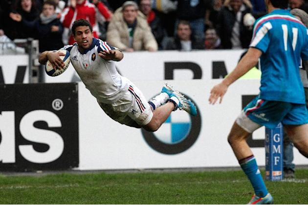 France's Wesley Fofana jumps to score a try during his Six Nations rugby union international match against Italy, at the Stade de France, in Saint Denis, outside Paris, Sunday, Feb 9, 2014. (AP Ph