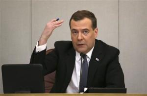Russia's PM Medvedev speaks as he visits State Duma, lower house of parliament, in Moscow