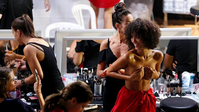 Models get ready backstage before the presentation of the Etam Live Show Lingerie at the Fashion Week in Paris, France