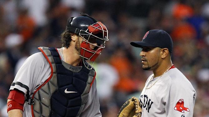 Boston Red Sox pitcher Franklin Morales, right, is visited by catcher Jarrod Saltalamacchia after giving up a RBI-single to Detroit Tigers' Jhonny Peralta in the fifth inning of a baseball game, Saturday, June 22, 2013, in Detroit. (AP Photo/Duane Burleson)