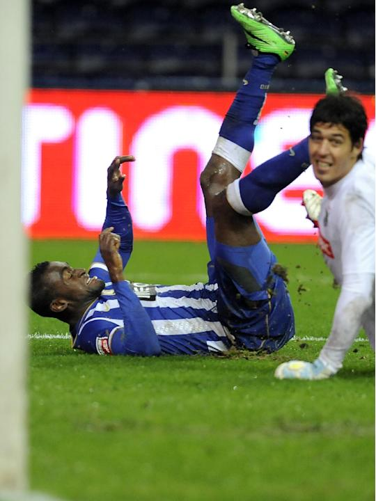 FC Porto's Jackson Martinez, left, from Colombia, reacts on the pitch after scoring his side's second goal past Pacos Ferreira's goalkeeper Matias Degra, from Italy, in a Portuguese League