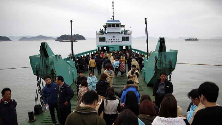 "Family members of missing passengers who were on the South Korean ferry ""Sewol"" which sank in the sea off Jindo, board a ferry ship heading to the accident site, at a port where family members of missing passengers have gathered, in Jindo"