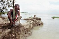 &lt;p&gt;A Bangladeshi villager sits on an eroding river bank on the Padma River in 2003. Bangladesh on Saturday called a World Bank decision to cancel a $1.2-bn loan to build the nation&#39;s biggest bridge -- aimed at transforming the poverty-hit south -- &quot;a bolt from the blue&quot;.&lt;/p&gt;