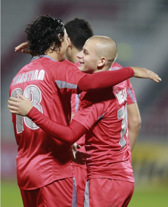 Qatar Lekhwiya's Suriaand Weiss celebrate a goal against Bahrain's Al-Hidd during their AFC Champions League match in Doha
