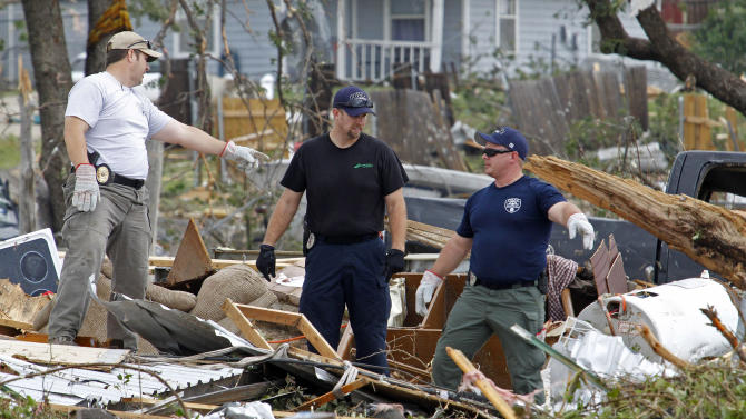 Emergency personnel continue search efforts to locate people in the destroyed Rancho Brazos neighborhood of Granbury, Texas, Thursday, May 16, 2013. Ten tornadoes touched down in several small communities in North Texas overnight, leaving at least six people dead, dozens injured and hundreds homeless. (AP Photo/The Fort Worth Star-Telegram, Paul Moseley)  MAGS OUT; (FORT WORTH WEEKLY, 360 WEST); INTERNET OUT