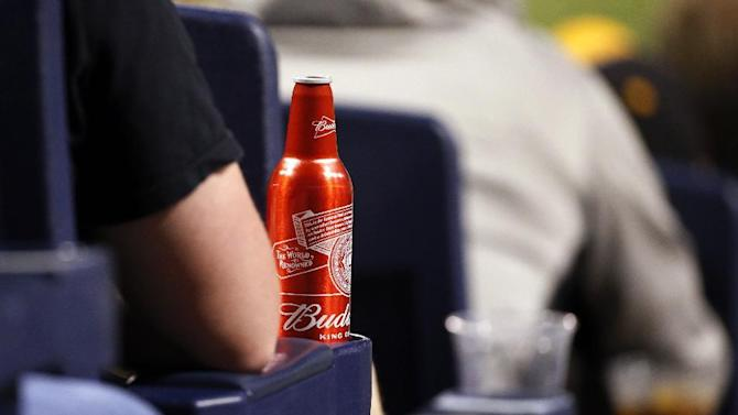 An aluminum bottle of Budweiser beer sits in a cup holder of a seat behind home plate at PNC Park during a baseball game between the Pittsburgh Pirates and the Milwaukee Brewers in Pittsburgh, Saturday, April 18, 2015. (AP Photo/Gene J. Puskar)