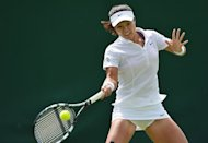 China's Li Na plays a shot during her first round women's singles match against Kazakhstan's Ksenia Pervak on the first day of the 2012 Wimbledon Championships tennis tournament at the All England Tennis Club in Wimbledon, southwest London. Li and Japan's Ayumi Morita kicked off the Asian challenge at Wimbledon with emphatic first round wins on Monday