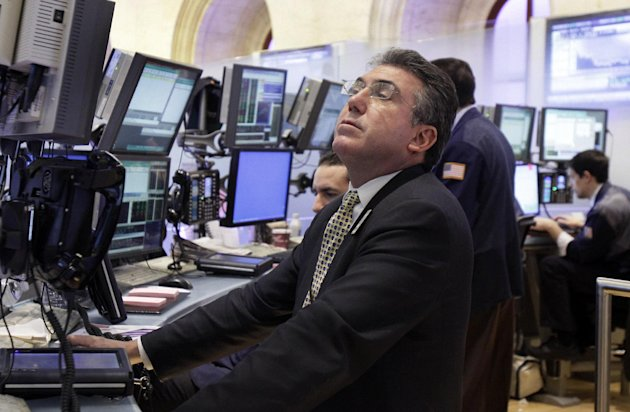 In this March 13, 2012 photo, trader John Bishop works on the floor of the New York Stock Exchange. Markets were buoyant Wednesday, March 14, 2012, a day after a fairly rosy assessment of the U.S. economy from the Federal Reserve boosted confidence about the state of the world's largest economy. (AP Photo/Richard Drew)