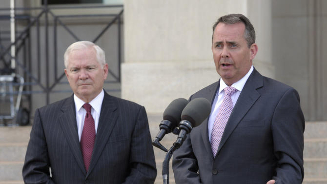 Defense Secretary Robert Gates and British Defense Minister Liam Fox take part in a joint statement at the Pentagon, Tuesday, April 26, 2011. (AP Photo/Susan Walsh)