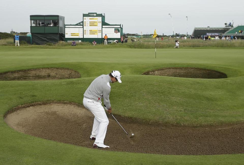 Adam Scott of Australia plays a shot out of the bunker on the 17th hole at Royal Lytham & St Annes golf club during the third round of the British Open Golf Championship, Lytham St Annes, England, Saturday, July 21, 2012. (AP Photo/Peter Morrison)