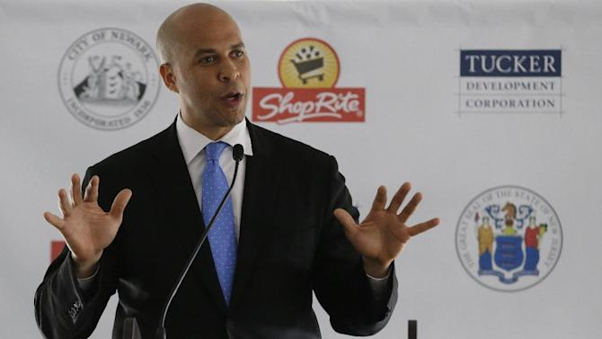U.S. Senator-elect Cory Booker talks during a groundbreaking ceremony for a supermarket, Thursday, Oct. 17, 2013, in Newark, N.J. A day earlier, Booker, who is the mayor of Newark, N.J., beat Republican Steve Lonegan during a special election to fill the seat left vacant by the death of Sen. Frank Lautenberg. (AP Photo/Julio Cortez)