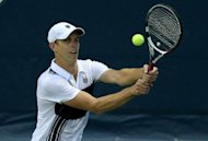 Sam Querrey returns a shot to Rageev Ram during their Los Angeles Open match on July 28. Querrey came back from a break down in the second set to reach his third straight final at his home event with a defeat of Ram 6-3, 7-6 (7/4)