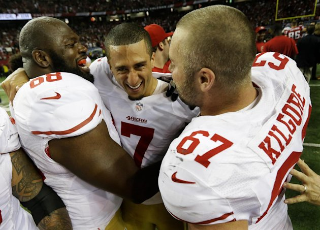San Francisco 49ers' Colin Kaepernick (7) celebrates with Leonard Davis and Daniel Kilgore (67) after the NFL football NFC Championship game against the Atlanta Falcons Sunday, Jan. 20, 2013, in Atlan