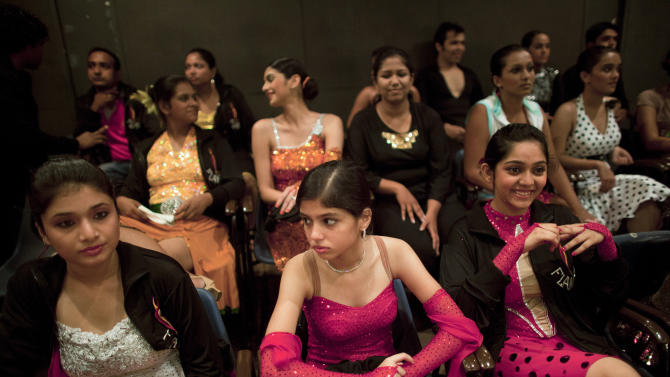 Spectators watch as contestants dance during the 4th annual Maharashtra State Open DanceSport Championship in Mumbai