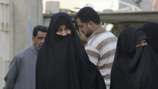 Relatives of Shaima Alawadi grieve during her funeral in the Shiite holy city of Najaf, 100 miles (160 kilometers) south of Baghdad, Iraq, Saturday, March 31, 2012. Alawadi, an Iraqi-American woman found bludgeoned to death in her California home last week, with a threatening note left beside her body, was buried in her native Iraq on Saturday. (AP Photo/Hadi Mizban)