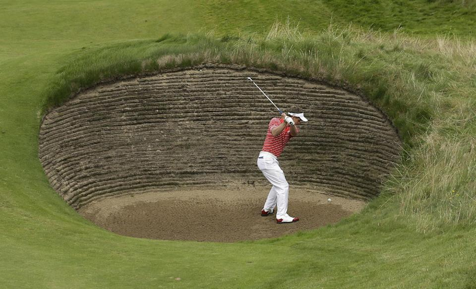Luke Donald of  England plays a shot out of a bunker on the seventh hole at Royal Lytham & St Annes golf club during the first round of the British Open Golf Championship, Lytham St Annes, England, Thursday, July 19, 2012. (AP Photo/Jon Super)