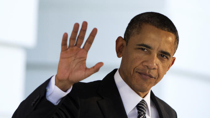 President Barack Obama waves as he leaves the White House in Washington, Saturday, Nov. 17, 2012,  for a trip to Southeast Asia. Obama will seek to reinforce American influence in Southeast Asia in spite of the large shadow cast by China.   (AP Photo/Manuel Balce Ceneta)