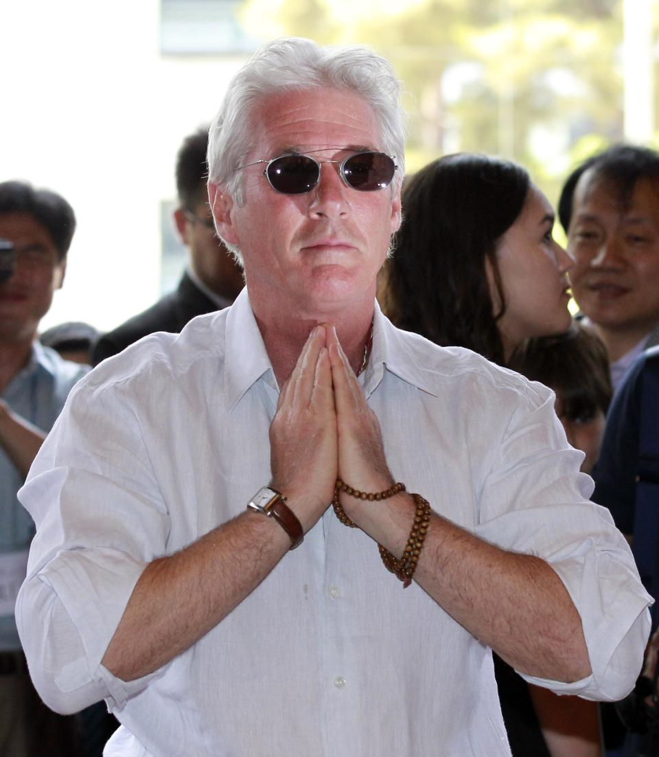 U.S. actor Richard Gere puts his hands together during his visit to the Korean Buddhism's Chogye temple in Seoul, South Korea, Tuesday, June 21, 2011. Gere is in South Korea for six days to promote his photo exhibition and tour Buddhist temples. (AP Photo/Lee Jin-man, Pool)