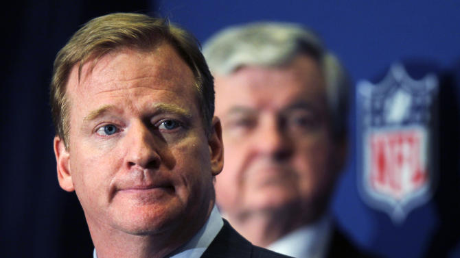 NFL Commissioner Roger Goodell announces that NFL owners have agreed to a tentative agreement that would end the lockout, pending player approval, on Thursday, July 21, 2011, in College Park, Ga. Carolina Panthers owner Jerry Richardson looks on in the background. (AP Photo/John Bazemore)