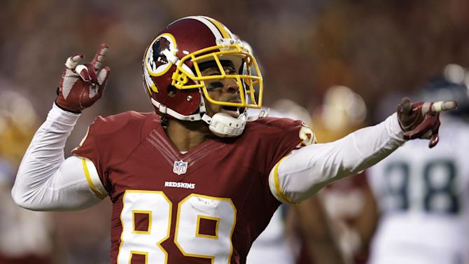 Washington Redskins wide receiver Santana Moss celebrates a play during the first half of an NFL wild card playoff football game against the Seattle Seahawks in Landover, Md., Sunday, Jan. 6, 2013. (AP Photo/Evan Vucci)