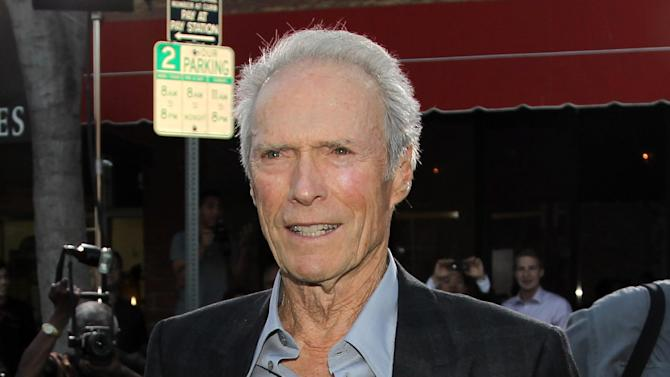 """FILE - This Sept. 19, 2012 file photo shows actor-director Clint Eastwood at the premiere of """"Trouble With the Curve"""" at the Westwood Village Theater in Los Angeles. In a wide-ranging interview Saturday about film directing at the Tribeca Film Festival, Eastwood said he admires the 104-year-old Portuguese director Manoel de Oliveira.  Said Eastwood: """"It would be great to be 105 and still making films."""" He laughed and called such a hope """"the ultimate optimism.""""  The director joined fellow filmmaker Darren Aronofsky for a staged conversation at the New York film festival following a screening of Richard Schickel's documentary: """"Eastwood Directs: The Untold Story.""""  (Photo by Matt Sayles/Invision/AP, file)"""