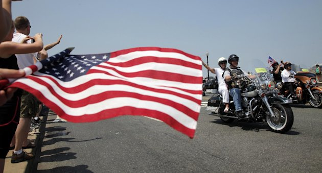 Motorcycles drive past on Memorial Bridge during the annual Rolling Thunder parade ahead of Memorial Day in Washington, Sunday, May 27, 2012. (AP Photo/Charles Dharapak)