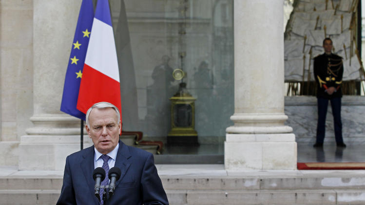 French prime minister Jean Marc Ayrault delivers a statement on measures to combat crime in Corsica following a spate of homicides and the creation of a public investment bank following the weekly cabinet meeting in Paris, Wednesday, Oct. 17, 2012. (AP Photo/Remy de la Mauviniere)