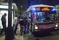 This photo provided by Metropolitan Transportation Authority shows people boarding a bus, as partial bus service was restored on Tuesday, Oct. 30, 2012. Mass transit, including buses, was suspended during Sandy, the storm that made landfall Monday. (AP Photo/Metropolitan Transportation Authority, Patrick Cashin)