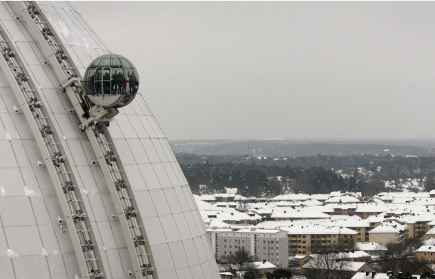 A glass gondola carries visitors to the top of the Ericsson Globe Arena during press preview of the Globen SkyView in Stockholm