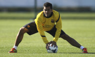FC Barcelona's Daniel Alves of Brazil works out during the team's training in Yokohama, near Tokyo, Monday, Dec. 12, 2011. Barcelona will play a semifinal match in the Club World Cup, on Thursday Dec. 15. (AP Photo/Junji Kurokawa)